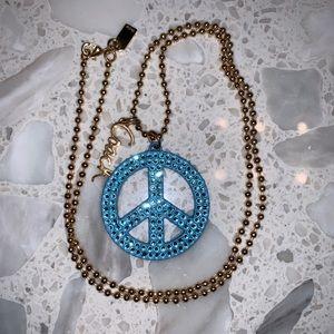 Coach Rhinestone peace sign necklace